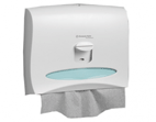 Dispenser for personal coverings on a toilet bowl