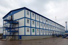 Modular buildings in Aktau. Cars are construction.