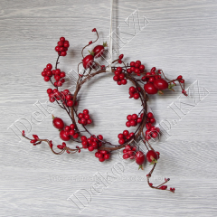 Wreath from berries and a dogrose on a rod