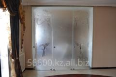 Sliding glass doors of a compartmen