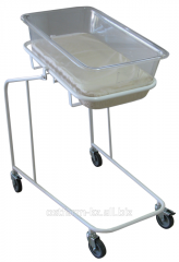 Bed - a trolley for new-born with the plastic