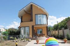 Дом отделаный фасадными панелями ИДЕАЛ вид 2