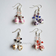 Graceful earrings with ceramic suspension brackets