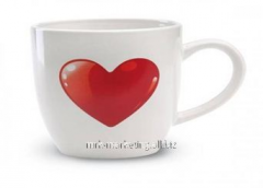 Ceramic mug with a heart from two parties of