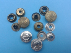 Buttons metal ring d 15 of mm with drawing in