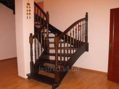 Ladder wooden on bowstrings with zabezhny steps