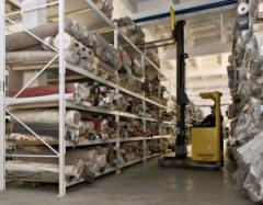 Warehouse for storage of rolls of fabrics