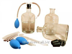 Set of bottles with the batcher for storage of