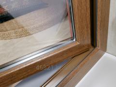Shtapik on a threefold double-glazed window a gold