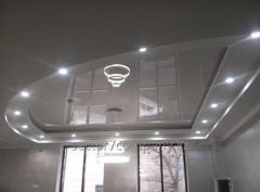 Glossy stretch ceilings with installation in
