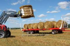 Agricultural platform for transportation of rolls