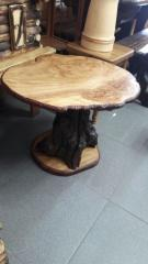 Coffee table from a cross cut of a karagach