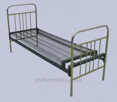 The bed is metal army