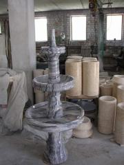 Decorative fountains from a natural stone in