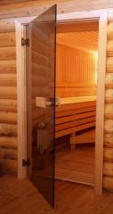 Doors glass for a sauna and a bath