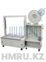 Automatic strepping packer (low table) of