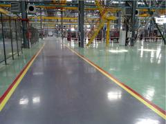 Floors are concrete industrial, with a polymeric
