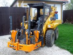 Optimal Opitz 650 (on a loader) with a lifting and