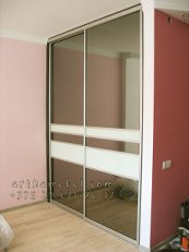 Accessories for sliding wardrobes of system for