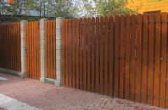 Wooden gate with a fence under the order Astana