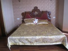 Bed wooden with a carving