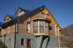 Houses from laminated board