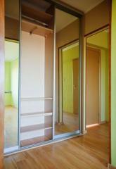 Sliding wardrobe mirror in a hall