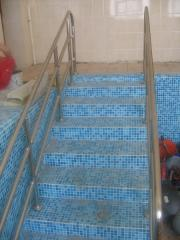Hand-rail to the pool with barrier
