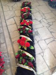 Garland from artificial flowers ritual