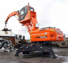 Loading crane of the wood and scrap metal of