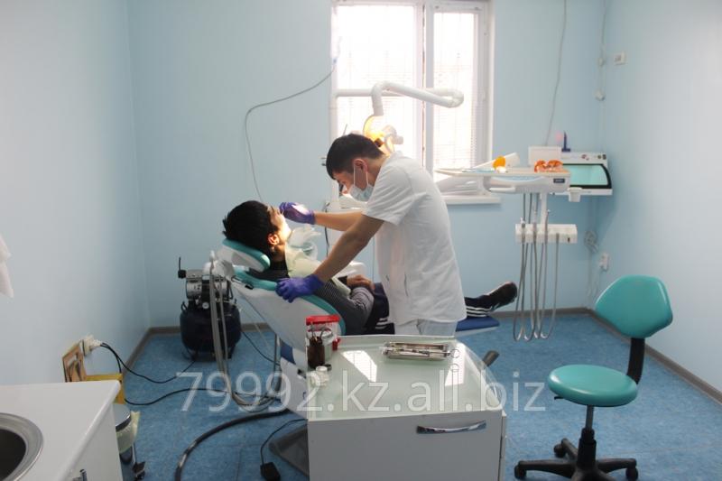 Заказать Удаление зубного камня