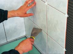 Finishing, installation, laying of a tile,