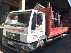 Доставка грузов на автомобиле оборудованным