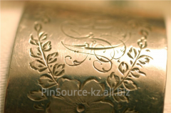 Engraving on metal, drawing by the laser, laser