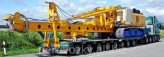 Transportation of road-building equipmen