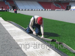 Laying of an artificial grass