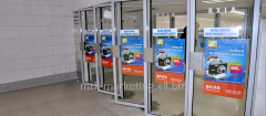Advertizing on doors of entrance and exit of the