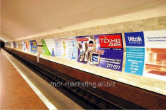Advertizing on traveling walls of the subway