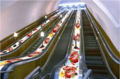 Advertizing on subway escalators