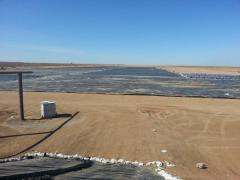 Laying and installation of a geomembrane on solid