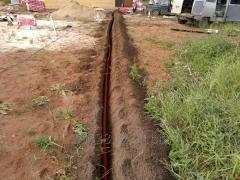 Laying of a cable in a trench