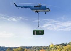 Freight handling in the cabin of helicopter or on