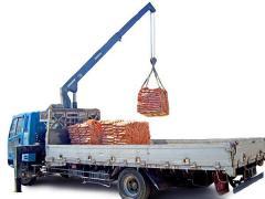 Перевозка строительных материалов на паллетах
