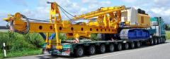 Transportation of road construction equipment