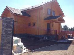 Строительство дома из дикого сруба
